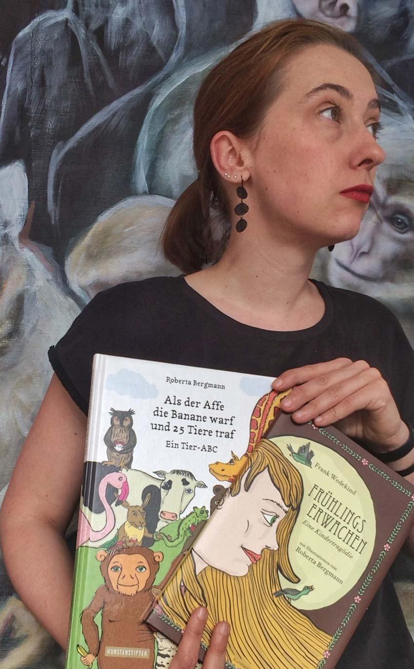 Roberta mit zwei illustrierten Büchern